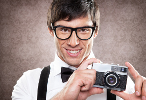 nerdy guy with camera